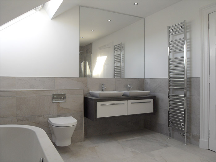Grey Slate Tiles With Strike Line Panel In Shower Area